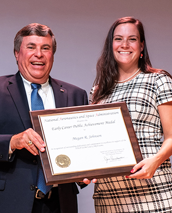 Megan Johnson receiving NASA Early Career Public Service Medal from GSFC Deputy Center Director, George Marrow, Jr.